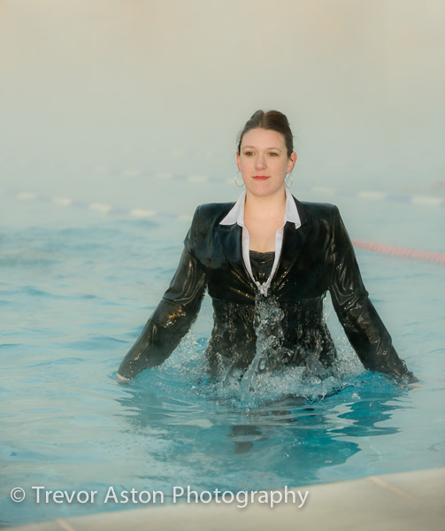 suit_wearing_woman_in_swimming_pool_business_family_photography_Richmond_Surrey_London