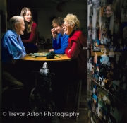 Family portrait of young people playing Scrabble with their grandparents