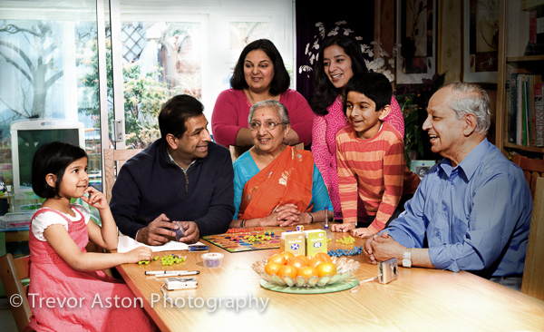 The family gathered around the table for their portrait photograph